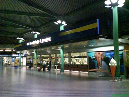 View of Schiphol Plaza with train ticket machines